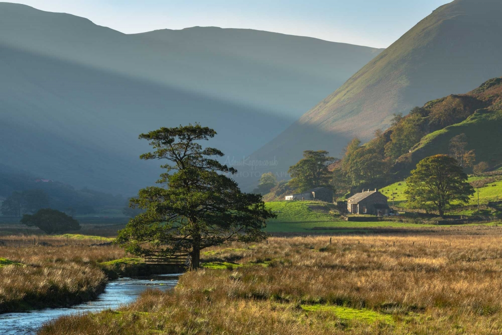 The Sun Breaking Through Onto The Nab Martindale. The Lake District