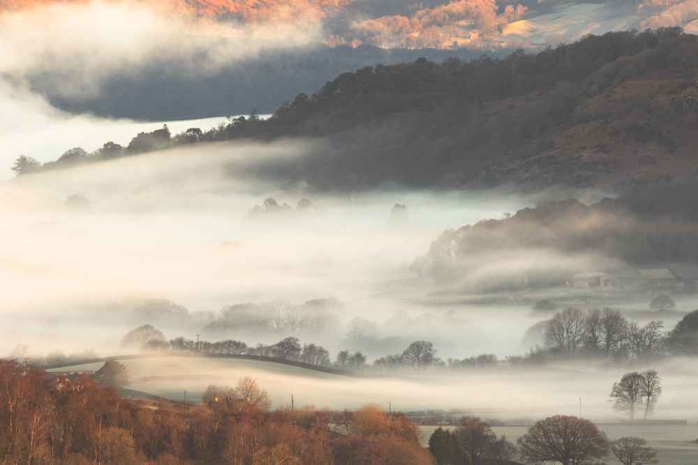 Clouds Rolling Through The Valley Covering The Fields Around Coniston