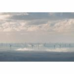 Clouds Being Churned Up By The Wind Turbines Loose Print